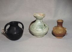 A Chinese green glazed small Hu jar, Han Dynasty (206 BC - 221 AD),13.8 cm high; a black pottery