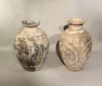 Two Chinese pottery ovoid vases painted with floral devices & leafy flourishes, in Tang style, 31.