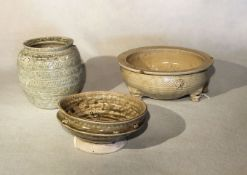 Group of three Chinese olive glazed pottery, Han/Warring States type, comprising: tripod circular