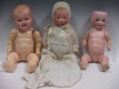 A collection of vintage and reproduction dolls with clothes