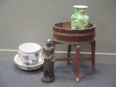 A 1920's coopered plant stand 60cm high and 65cm wide, a wash pail and bowl Losol ware, a bronzed