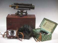 A Charles Baker, London, surveyor's level, no.3822, boxed with tripod and staff; a pair of