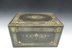 A mother of pearl inlaid dressing case
