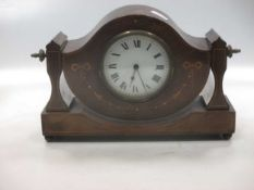 A mahogany and inlaid mantel time piece, with swivel top, 26cm wide