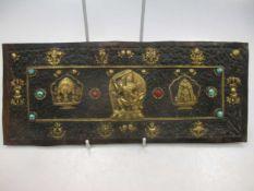 A possibly Tibetan rectangular metal embossed plaque gilt mounts
