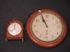 A modern mantle clock by Comitti in mahogany case 24cm high and a wall clock with hes movement