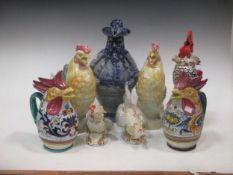 Collection of model china cockerells and a German stoneware rotund figural jug (8)