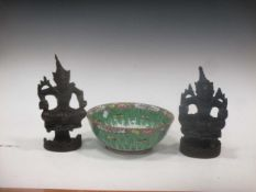 A 20th century Cantonese bowl with repeated butterfly motifs; and two Asian carved deity figures (