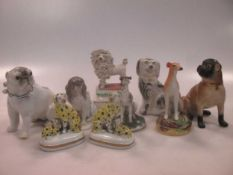 A group of nine small ceramic model dogs, mainly Continental (9)