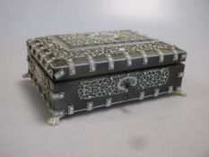 A late 19th or early 20th century Indian ivory mounted table casket and two whist markers