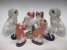 Four small size pairs of Staffordshire dogs and one other spotted (9)