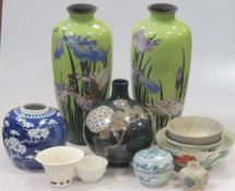 A collection of Asian ceramics, including blanc de Chine cup and a bowl, provincial blue and white