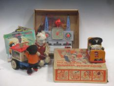 Collection of Japanese and other part tinplate toys, including flying saucer, Dan Dare Radio