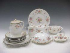 A Wedgwood porcelain part dinner service, a Minton part tea set and a Foley China part coffee