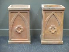 A near pair of terracotta planters decorated with gothic arches and quatrefoil 70.5 x 41 x 43cm