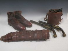 Two brass inlaid flintlock pistols, together with a pair of leather cased field binoculars and