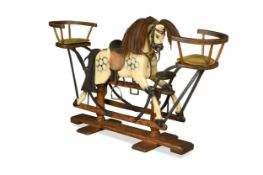 A dapple grey painted wooden rocking horse, 20th century,