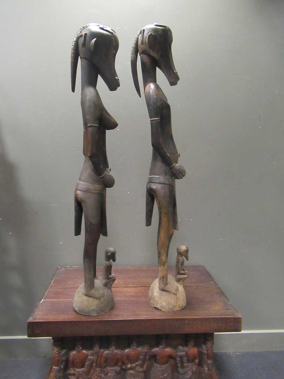 A pair of Senufo style rhythm pounders, comprising of a male (132cm high) and female (129cm high) - Image 2 of 8