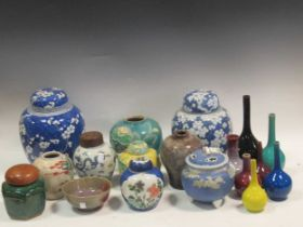 A quantity of ginger jars and other cermaic vases, including two larger blue and white ginger