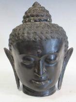 A 20th century bronze head of Buddha 37cm high