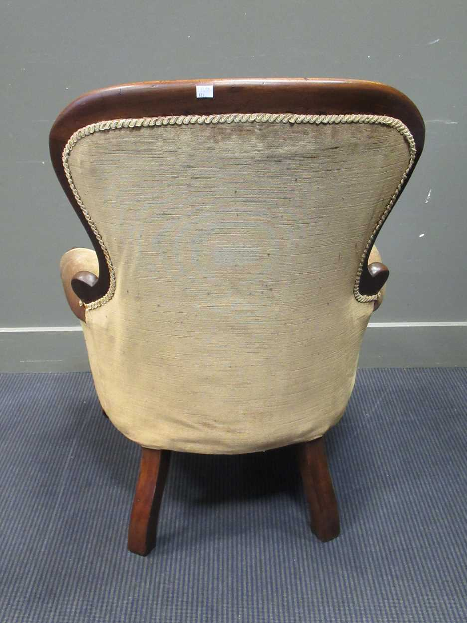 A mid-Victorian mahogany button back scroll carved armchair on turned legs and ceramic castors - Image 2 of 5