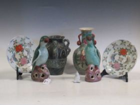 A pair of Chinese models of parrotts, a pair of Chinese small plates and a two-handles vase; a