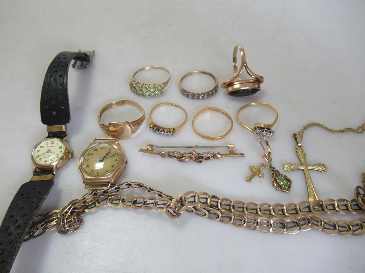 A group of gold jewellery, including a hallmarked 9ct gold chain, a hallmarked signet ring, a