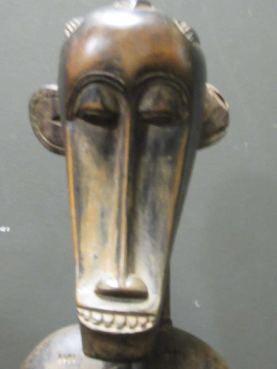 A pair of Senufo style rhythm pounders, comprising of a male (132cm high) and female (129cm high) - Image 7 of 8