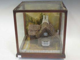 Diorama of a Swiss cottage in a glazed case, 35 x 32 x 30cm