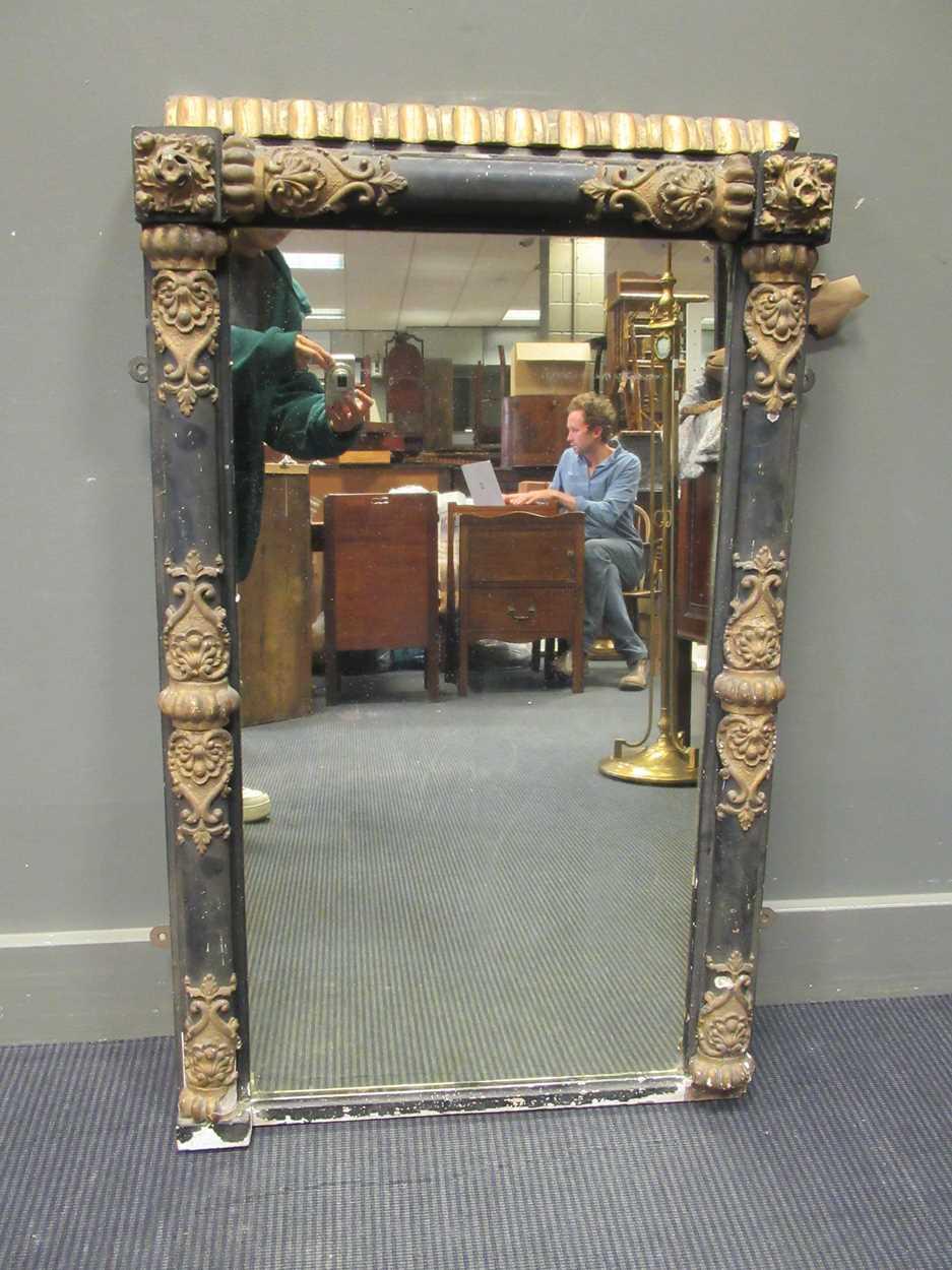 A 19th century ebonised and gilt wood overmantel mirror 104 x 63cm