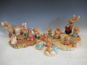 A large collection of Pendelphin rabbits together with two Pendelphin stands and a Steiff tiger