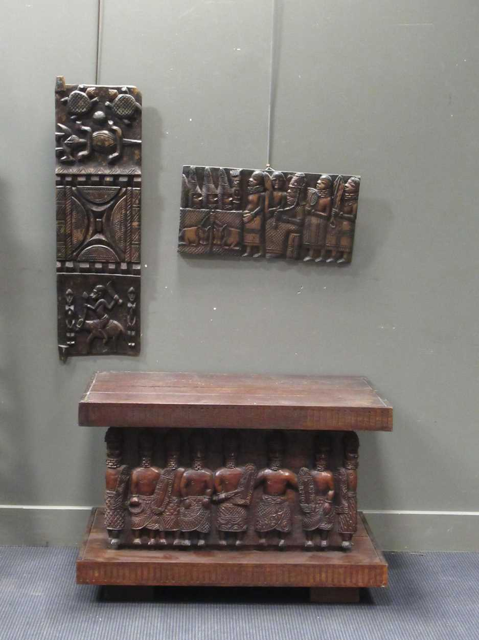 A Benin carved wood rectangular casket table 64 x 97 x 61cm together with a Benin carved wood