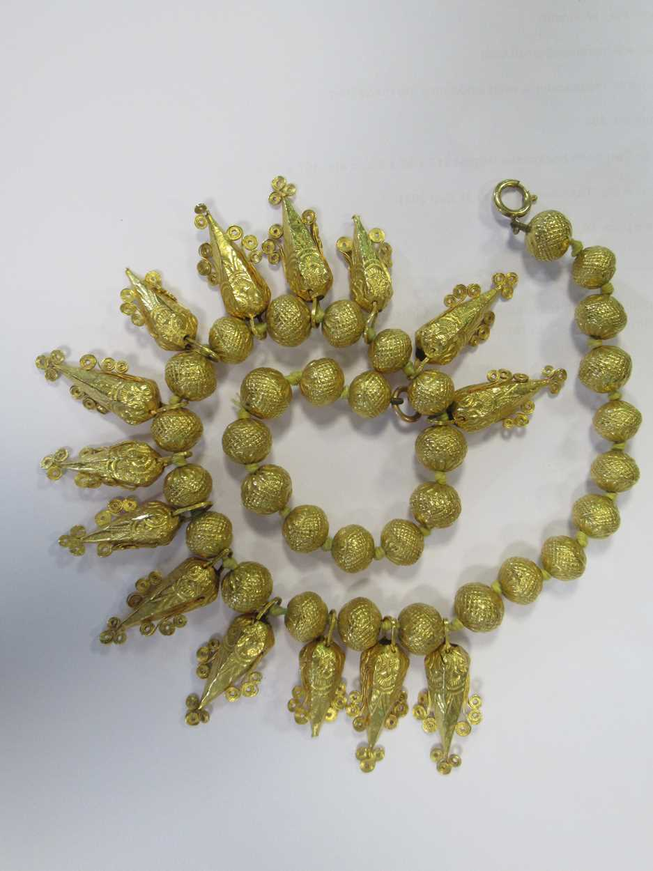 An Indian wax filled bead necklace, tested as 22ct gold, gross weight 83.2g, together with a - Image 7 of 14