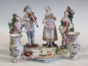A pair of continental porcelain figurines, two Chelsea style figurines, a pair of Sampson