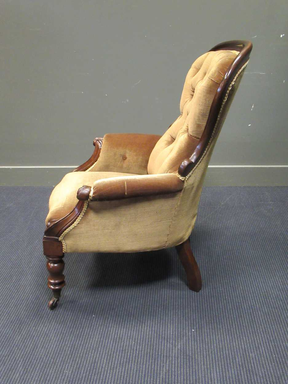 A mid-Victorian mahogany button back scroll carved armchair on turned legs and ceramic castors - Image 4 of 5