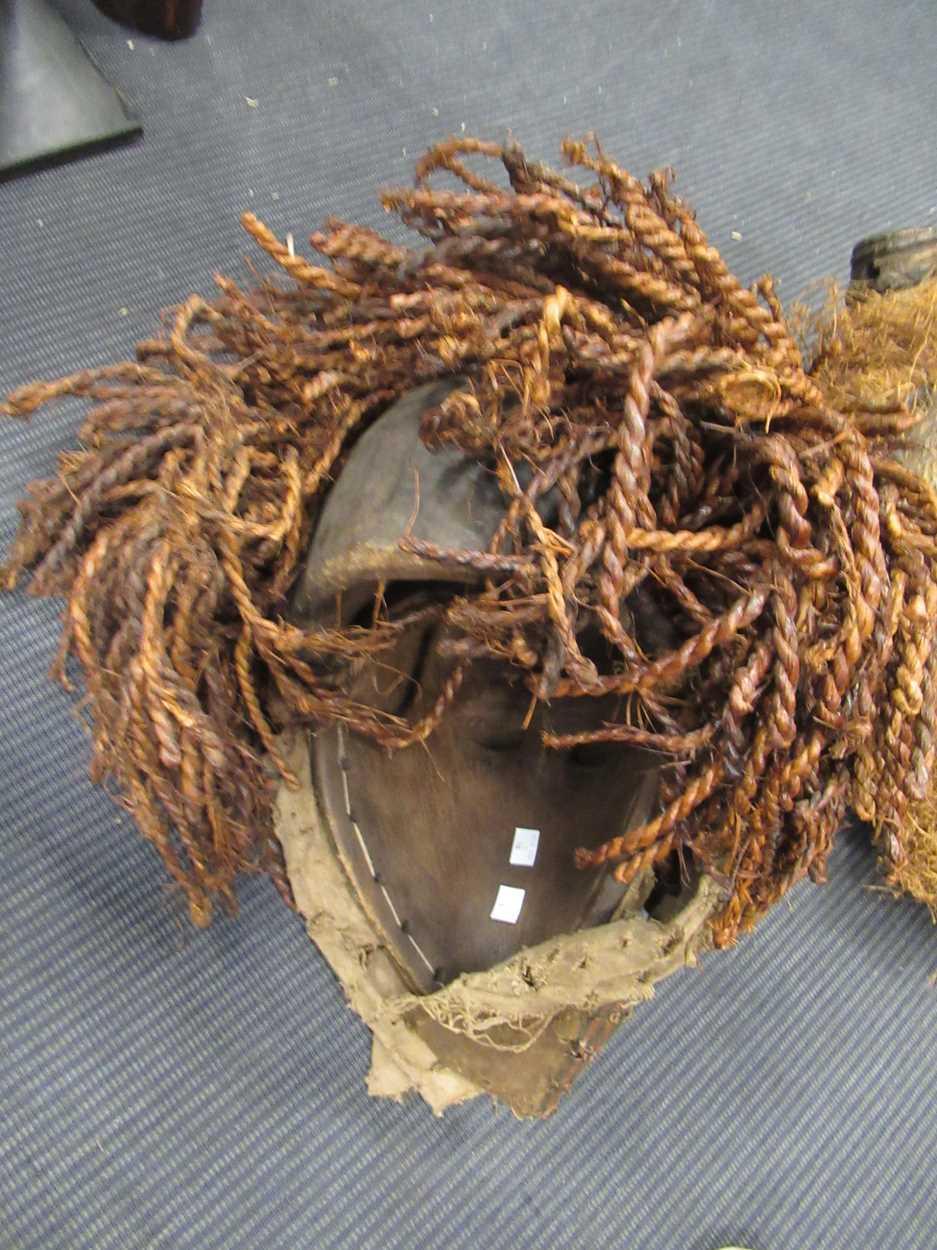 A Chokwe mask, a Yoruba Gelede mask, a Salampasu mask decorated with copper sheets and a Yaka type - Image 3 of 6