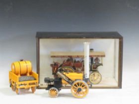 A miniature steam engine in a glazed wooden case and a Hornby model of The Rocket (2)