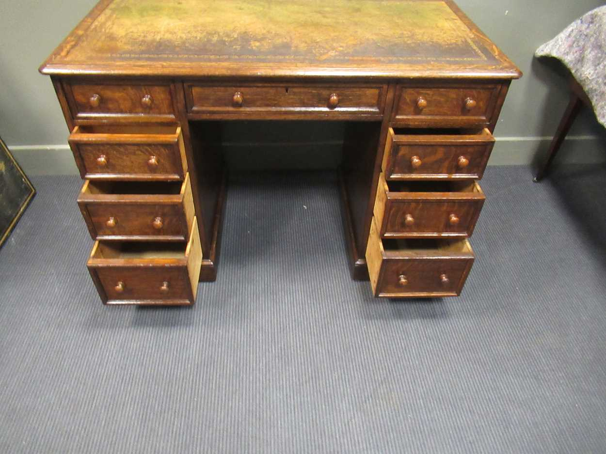 """A late Victorian oak twin pedestal writing desk stamped """"1209 Wilkinson & Son 8 Old Bond Street"""" the - Image 5 of 9"""