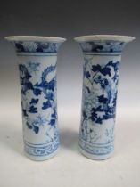 A pair of Chinese blue and white cylindrical vases 41cm highCondition report: Marking, scratching