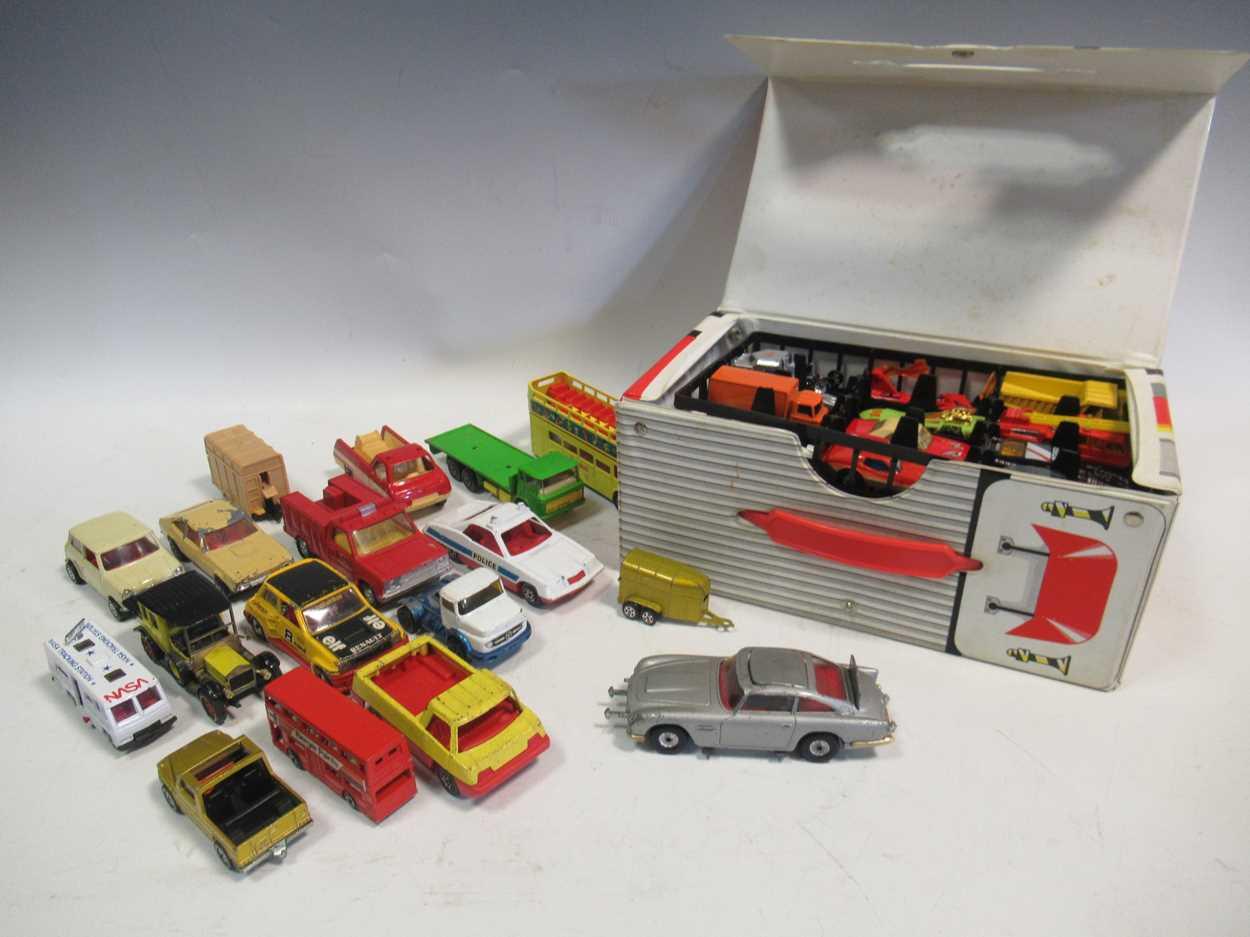 A collection of Corgi, Matchbox and Dinky diecast cars, including a Corgi 007 Aston Martin DB5, with