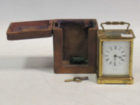 A brass carriage clock, dial inscribed 'Tain H Paris', in a travelling case