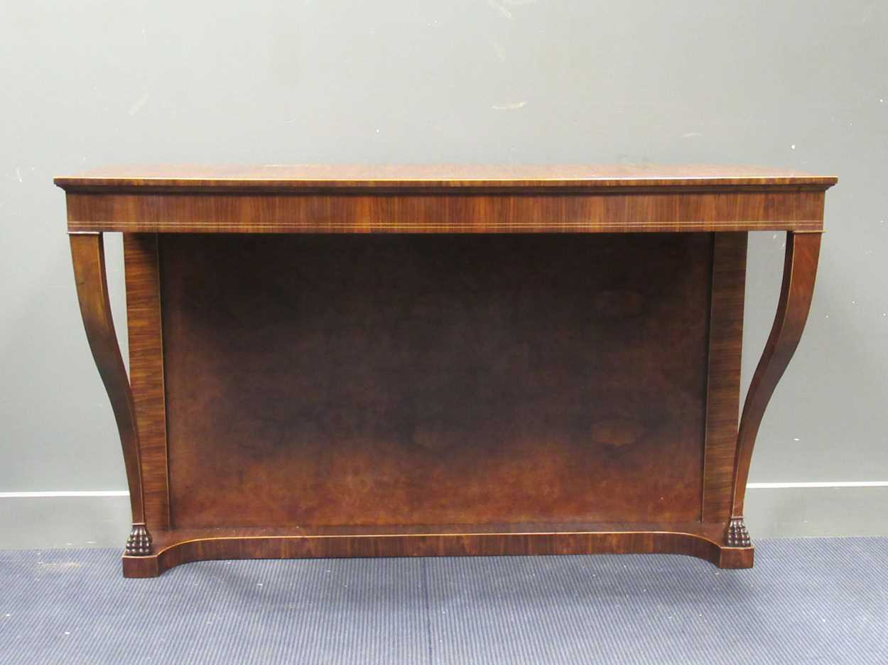 A Georgian style walnut consul table on lion paw carved foot supports 98 x 156 x 55.5cm