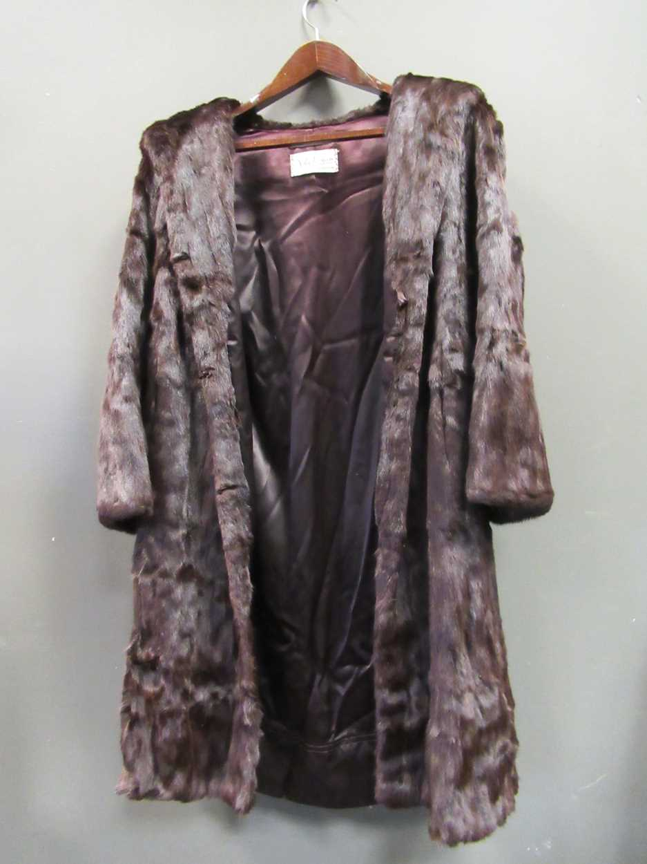 A mink three quarter length fur coat and another white knee length fur coat both size 12/14