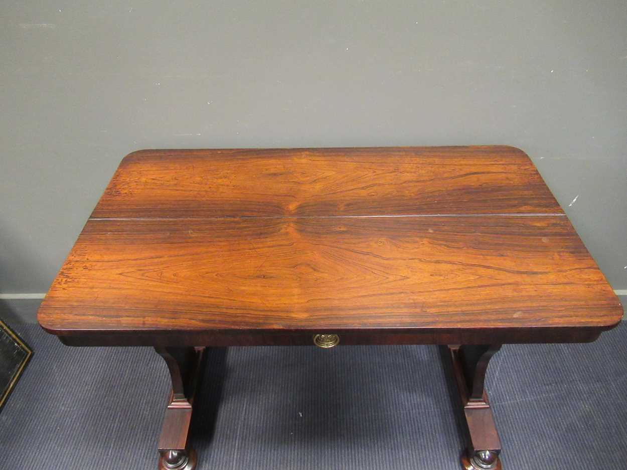 A circa 1830 rosewood library table with single frieze drawer on bun feet and brass castors, 72 x - Image 6 of 6