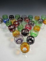 A set of coloured drinking glasses