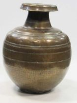 A large bronze bulbous vase, probably 19th century Indian, with inscription in stylised script