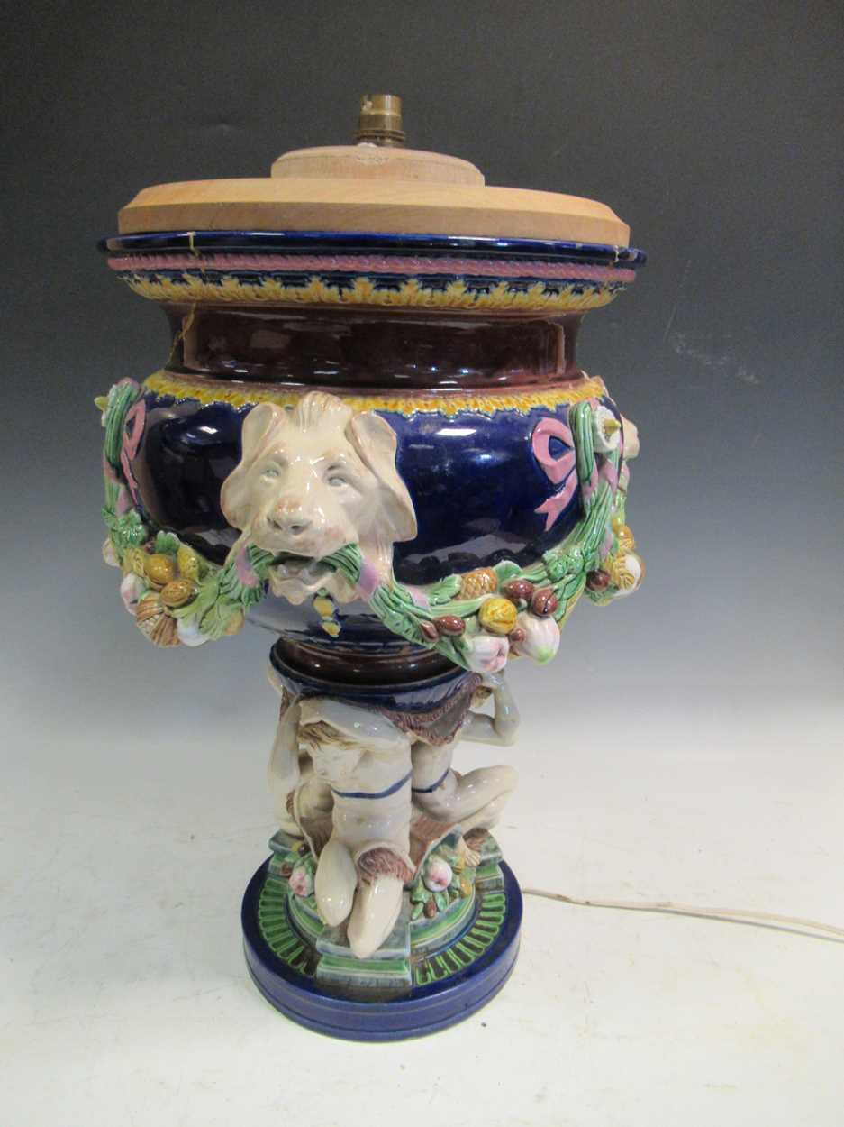 A large Minton majolica vase, moulded with garlands supported by animal heads, impressed mark,