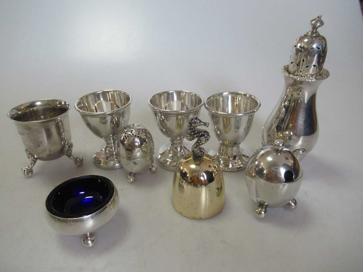 A collection of silverware including 3 toastracks, 4 egg cups, 2 tea strainers, a pepper caster, a - Image 2 of 6