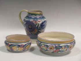 A Poole pottery 1930's jug and two bowls