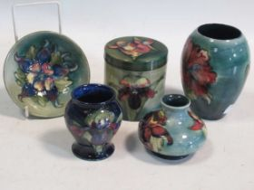 A small collection of mid-century Moorcroft, comprising an Orchid pattern jar and cover, an Orchid